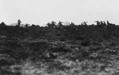 (1 of 2) German storm troops race to occupy a newly-made mine crater near Ripent (Champagne).