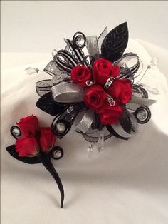 Red roses with black and silver accents For Bailey Red Corsages, Prom Corsage And Boutonniere, Flower Corsage, Corsage Wedding, Wrist Corsage, Wedding Bouquets, Boutonnieres, Homecoming Flowers, Homecoming Corsage