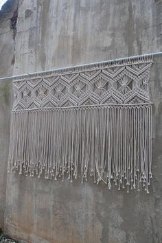 Large Macrame wall hanging / macrame headboard. Ready to ship Width- 150 cm Knotted part from the dowel: 37 cm Length from the stick- 102cm (41 inch) Fringes- 65cm (27 inch) Please NOTE, this item is not coming with a dowel/stick. This Wall hanging has also a matching runner. Please check
