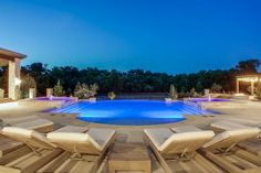 A two-tiered pool with dual spas offers twice the fun at this Westlake, Texas, home. Trimmed by an outdoor kitchen and dining space, grilling zone, lounge area and water slide, this outdoor retreat proves everything is bigger AND better in the Lone Star State.