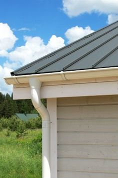 7 Metal Roofing Pros and Cons to Consider - Bob Vila Galvanized Metal Roof, Corrugated Tin, Corrugated Roofing, Metal Roofing Systems, Steel Roofing, Roofing Materials, Metal Roofing Sheets, Build My Own House, Garage Door Design