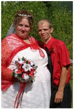 A touch of red gave so much fantasy to our nice wedding costumes.