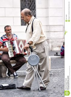 Photo about An elderly man with a walking crutch in the city. Behind him, a street artist with the accordion. Image of living, invalid, cultural - 45115963 Piazza Navona, Elderly Man, Crutches, Rome Italy, Street Artists, Walking, Stock Photos, City, Image