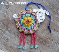 Colorful crochet 'flower sheep' by ATERGcrochet