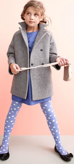 Little girl outfit: periwinkle blue dress with grey coat and polka dot tights.