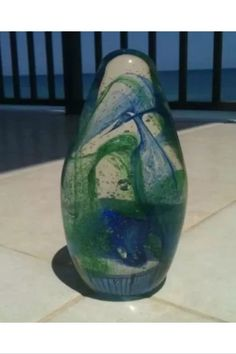 """captivating blue green swirling turquoise glass sculpture  approximately 7"""" http://www.bonanza.com/listings/captivating-blue-green-swirling-turquoise-glass-sculpture-approximately-7-/313390934"""