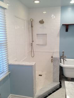 This bathroom features a porcelain marble-look with a classic white subway field tile. ...