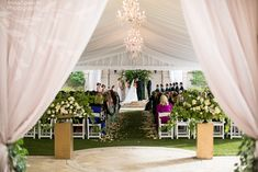 Anna and Spencer Photography, Atlanta Documentary Wedding Photographers. Wedding ceremony at the St Regis in Atlanta under a draped tent with chandeliers.