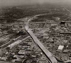 Oblique aerial view easterly along the mostly-completed I-10 Santa Monica…