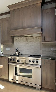 Grey Stained Kitchen With Wood Hood  Design Ideas