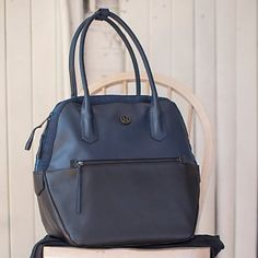 Lululemon Happy Hatha Bag Like new Lululemon navy and black Happy Hour Hatha bag.  This bag is amazing, it has so many different compartments to help keep you organized and easily fit everything you need. There is a little wear on the bottom of the bag (pictured) but others wise in excellent condition. Not sure If I want to sell this or not, but open to REASONABLE offers! lululemon athletica Bags