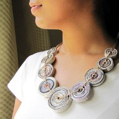 Environment-friendly designer necklace handcrafted from newspapers.