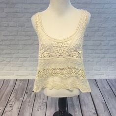 Cute Lacey Top! Cute lace accent top! It is very sheer so probably need to wear something under (or not.. You do you 🙃). Worn but well taken care of! More pics on request and offers welcome! Tops Tank Tops