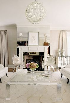 greige-Love the softness-lucite table & globe ceiling fixtures, fireplace all beautiful focal points.