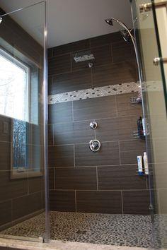 Charcoal black pebble tile shower floor. https://www.pebbletileshop.com/products/Charcoal-Black-Pebble-Tile.html#.ViveV36rTIU