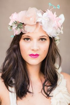 A Fantastic Tale: a gorgeous floral crown for the bride at a glamorous fairy tale wedding.