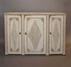 """Swedish sideboard in the Gustavian style, circa 1860. Three doors separated by fluted pilasters, each having raised, reeded lozenges and foliate carving in the corners. Dentil molding around the top.  H:37¾"""", W:58"""", D:21¼"""".  Ref. #33-39"""
