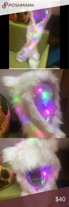 Light Up Led Fur Hood Hat wrap festival rave 😻 This light up hood is the best! It has room for your phone and other treasures in the pockets at the end of the scarf! The lights can be turned on or off. Love the ears! Take it to your next rave or festival! Accessories Hats
