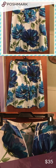 EUC Lane Bryant floral A line skirt sz 14 Worn once. Lane Bryant white & blue floral print skirt sz 14. Material has stretch to it, there is a zipper in back at top. Waist measures 36 & length is 25 inches Lane Bryant Skirts Asymmetrical