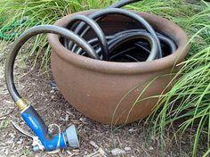 garden hose storage with the grass