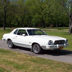 1974 Ford Mustang II My first car was white with a beige vinyl roof