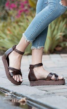 Dark brown BEDSTU platform sandals styled with cut raw edge denim for a casual comfortable look.