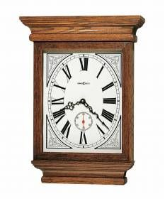 613-239 Howard Miller Oak Quartz Wall Clock ,Dial decorative | Fables-Impressive moldings on the top and base. Dial features decorative corner spandrels, rich brown Roman numerals, and a separate second hand track with a red hand.