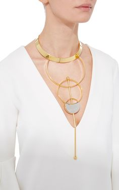 This sleek necklace by **Monica Sordo* features a choker style at the neck attached to overlapping rings that descend in size. An optional bar strike this necklace for an extra element of edge.
