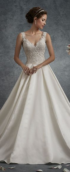 Lace bodice satin skirt wedding dress. Sleeveless A-line gown with V-neckline, hand-beaded lace appliqué bodice, keyhole back finished with corset.