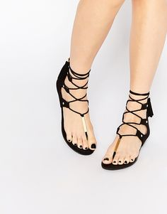 ALDO Jakki Black Gladiator Tassel Flat Sandals at ASOS. Aldo Sandals, Flat Gladiator Sandals, Black Sandals, Aldo Shoes, Strappy Sandals, Shoes Sandals, Pretty Sandals, Beautiful Sandals, T Strap Flats