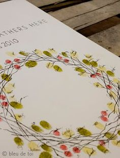 fingerprint craft, would be a cool Easter wreath because it kind of looks like a crown of thorns...could be a neat theme.