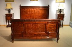 """A stunning quality """"plum pudding"""" mahogany kingsize antique French bed."""
