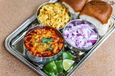 "Misal pav (spicy curry with bread – ""pav"") is a traditional Indian dish. It consists of spicy curry usually made of sprout of Mataki or white peas and chilly powder gravy called 'Kutt'. The final dish is topped with Potato-Chiwda Mix, Farsan or Sev), onions, lemon and coriander (cilantro). It is usually served with bread … … Continue reading →"
