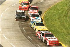 Kenny Schrader's Thunderbird racing car leads Dale Earnhardt, Greg Sacks, Terry Labonte, AJ Foyt and Darrell Waltrip at Martinsville.
