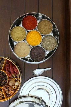 Indian spice box or masala dabba - It is essential, very functional in almost every Indian household's kitchen. You should have it, if you are cooking Indian food more frequently.