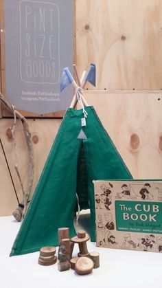 Emerald green 100% linen with sky blue flags. Available at Pint Size Goods.