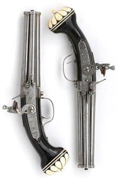 Pair of four-barrelled flintlock turn-over pocket pistols   by Cornelis Coster  Utrecht  circa 1660