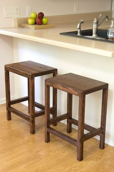 Simple Bar Stools made out of a couple 2x4s. | plans by Jays Custom Creations.