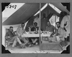 https://flic.kr/p/71SCC2 | Expedition members in tent with chief | Expedition members in tent with chief. Probably village of Davart, seat of Dejasmatch Ayula. 1927.  Name of Expedition: Daily News Abyssinian Expedition Participants: Wilfred Osgood, Louis Agassiz Fuertes, C. Suydam Cutting, Jack Baum, Alfred M. Bailey Expedition Start Date:  September 7, 1926 Expedition End Date: May 20, 1927 Purpose or Aims: Zoology Mammals and Birds Location: Africa, Ethiopia [Abyssinia]   Original…