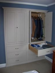 This cabinet was built and installed in a standard double sliding door closet to maximize storage. this