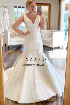 #Lazaro bridal gown - Ivory Floral silk satin daisy embossed #mermaidgown, V neckline front and back, structured bodice, natural waist, elongated torso with circular skirt, chapel train. Also available in solid Ivory. #lazarobridal Lazaro Bridal, Bridal Gowns, Wedding Dresses, Bodice, Neckline, Mermaid Gown, Chapel Train, Timeless Elegance, Silk Satin