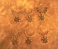 Snowflake wine charms by Eastsidelights on Etsy, $6.50