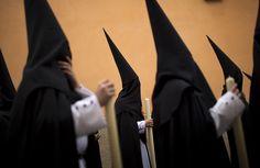 "Nazarenos (hooded penitents) from ""Santa Genoveva"" brotherhood take part in a procession in Seville, Spain, Monday, March 25, Semana Santa (Holy Week) 2013. (AP Photo/Emilio Morenatti)"