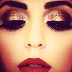 Gold and bronze eye makeup and red lips♥