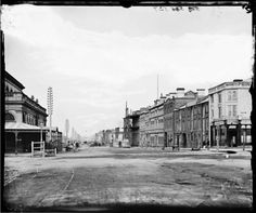 Looking west along Flinders Street from Joshua Mooney's Princes Bridge Hotel and the Fish Markets on the corner of Swanston Street, Melbourne 1870.