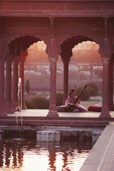 Lahore, Pakistan, 1981. Tahira Sayed playing the sitar in the Shalimar Gardens. Photograph by Roland and Sabrina Michaud.