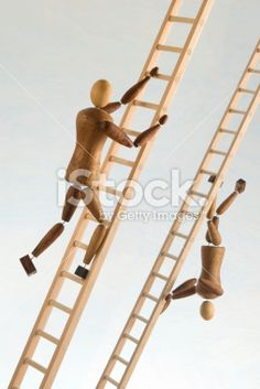 Two wooden figures climb ladders in opposite directions.