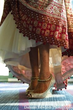 The bride wears traditional Indian bridal attire with glamorous shoes. indian bridal shoes wedding bride dulhan desi groom www.amouraffairs.in