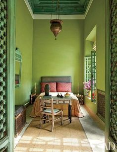 A Persian light hangs in the Green Bedroom of a Marrakech riad by Sardar Design Studio; the bedspread is Gujarati mirrorwork embroidery, the chest is Moroccan, and the desk and chair are embellished with bone inlay. Bedroom Green, Bedroom Decor, Moroccan Bedroom, Bedroom Retreat, Bedroom Modern, Ethnic Bedroom, Bedroom Ideas, Narrow Bedroom, Master Bedroom