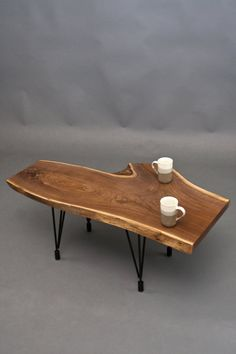 Reclaimed Wood Furniture  Black Walnut Reclaimed Coffee Table  Adjustable Black Steel Hairpin Legs    All natural shape created from a unique cut of Black Walnut. This table has all the other beautiful fixings of American Black Walnut - with it's natural rich character, deep flowing grain lines that ebb and move through out the entire piece.